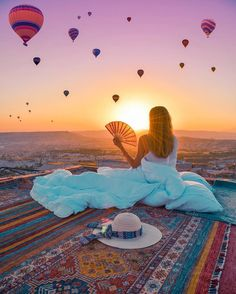 Enjoying a magical sunrise on the rooftops of #Cappadocia #Turkey // Photo by Jennifer Mel Tuffen (@izkiz)