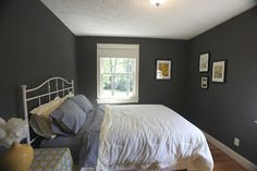 here's a dark grey wall in a bedroom. just remember the smaller rooms will look even smaller i think with a dark color.