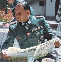 Generaloberst of the Waffen-SS Sepp Dietrich leafs through his newspaper while enjoying the beautiful day in Hitler's mountain retreat. One of Germany's most decorated soldiers of WW2, Dietrich had no military education and was a one-time waiter and butcher. His lead role in the Night of the Long Knives, and his close association with Hitler as bodyguard and chauffer, ensured his rapid career climb.