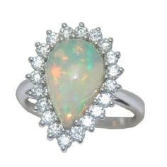 Opal Ring with 3/4 cttw. Diamonds in 14 kw https://www.goldinart.com/shop/colored-gemstone-rings/opal-ring-with-34-cttw-diamonds-in-14-kw #14KaratWhiteGold, #OpalRing