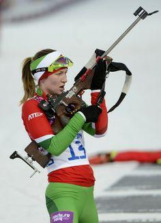 Lock & load & ski. Darya Domracheva of Belarus in action during the women\'s 15K individual biathlon race.