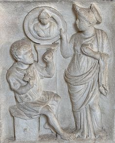 Matrona with a Flavian hairstyle looks on as a sculptor works on a portrait funeral stele on this marble funerary altar. Vatican Museum: Candelabra corridor