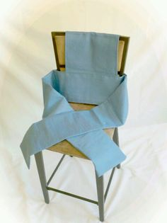 Weighted Hug Chair - Weighted Hug Chair is designed to cover the back of a chair and has to weighted sleeves that wrap around the person sitting.