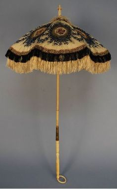 Brocade parasole with double row of fringe, mid 1860's