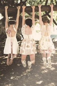springtime tree climbing in pretty dresses. yes please.