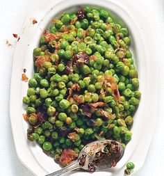 Sweet Peas with Prosciutto (Piselli al Prosciutto)  In this classic Roman contorno, or side dish, sweet peas are braised until tender, then sautéed with salty prosciutto.