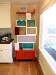 love the stacking of odd shaped storage boxes