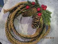 BLACK BARB WIRE & ROPE WREATH; PINE CONE, RED BERRIES & GREEN PINE BOUGH ACCENT