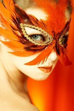 Orange feathers mask.