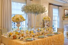 Absolutely beautiful, from the soft yellow ruffled tablecloth, to the large baby breath arrangement. What's not to love?