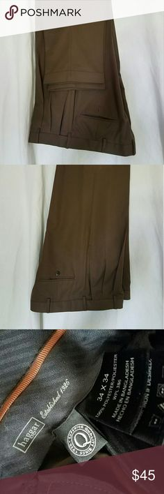 Haggar Men's Dress Pants FATHER'S DAY SPECIAL!!!   Brown men's dress shirt pants with pleated front and cuffed at bottom. Worn once. Size 34x34. Haggar Pants Dress