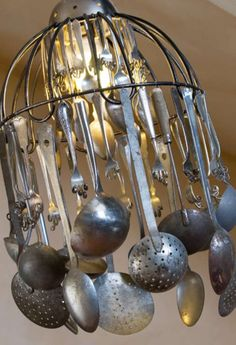 The latest decor craze is the repurposing of vintage items into accesssories for the home and garden. Create an interesting kitchen chandelier with an assortment of ladles, spoons and sieves.