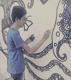 Yo pintando en mural de la escuela
