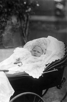 Queen Elizabeth's father, King George VI in his pram as a baby in 1895.