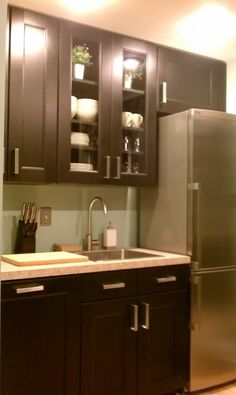 think of the basement move the fridge on another wall these are ikea cabinets kitchenette ideasbasement