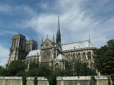 Notre Dame, Paris, is a grand Gothic cathedral with Towers at one end and a small spire rising from the centre of the roof. Atelier Architecture, French Gothic Architecture, Saint Chapelle, Gothic Cathedral, Ile Saint Louis, Tourist Trap, Commercial Architecture, Sully, Pictures Images