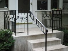 Iron step railing with leaf and vine design