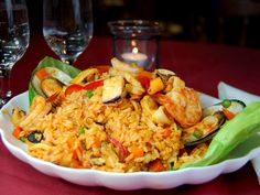 Arroz con Mariscos is a lot of rice with some vegetables and seafood mixed in – clams, mussels, shrimp, squid, and fish.