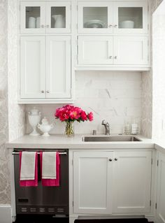 Id like this in my laundry room. but with a washer and dryer instead of a dish washer lol. i adore the cabinets and the splash of pink.