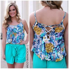 """We just can't get enough of trendy tropical print this season! This airy swing crop top features spaghetti straps and strappy back. 100% Rayon Also shown: Beach Bum Shorts. Small Medium Large Bust 32"""""""