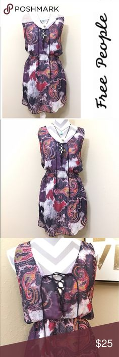 """Free People BoHo Chic Lace Ip Dress EU/Like New Condition. Super light weight, has a second layer/slip underneath. Has a slight high-low hem (as shown in pics) The waist area has an elastic band to fit your curves/allows you to raise the waist higher if you so choose (as shown in pic) Shoe-lace-up front cleavage which is all the rage right now. And the best detail, 2 side slit pockets!                   Measurements Laying flat:    Length 34.5"""" in the front, 36"""" in the back- slight hi-low…"""