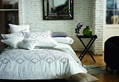 Cozy bed. Exposed brick. Cannot wait to use it