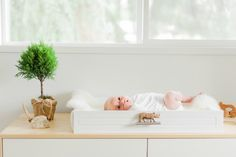 Creative idea for a changing station!  An old wood drawer with a sheepskin fashioned into a changing pad.