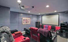 A cinema room appears muted in colour compared to the other pink areas Teal Walls, Black Walls, Michigan, Retro Interior Design, Bright Color Schemes, Room Screen, Retro Home Decor, Home And Living, Interior Decorating