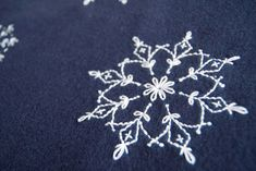 Snowflake embroidery pattern  You can follow this one or cut your own snowflake pattern and trace it on your fabric for embroidery