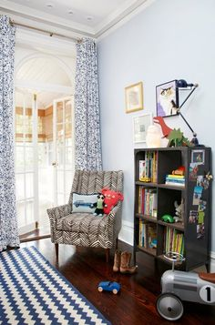 Suzie: Amie Corley Interiors - Adorable boy's bedroom with pale blue walls paint color, white & ...
