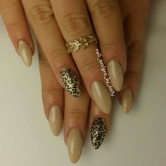 Nude and gold leopard print nails