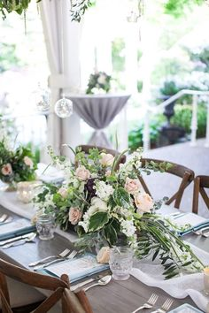 Organic Luxe Garden Wedding near Nashville. Love these grey farm tables and the muted blue, peach and green florals. Southern chic! Venue: CJ's Off the Square Florist: The Enchanted Florist Rentals: Southern Events Party Rental Printed Pieces: Designs in Paper Lighting: Nashville Event Lighting