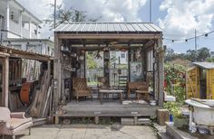 This New Orleans Backyard Has an Airstream, a Music Stage & Clawfoot Tubs — Backyard Tour