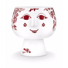 Rosendahl  Red Bjørn Wiinblad Flowerpot Juliane Decor: Red Bjorn Wiinblad flowerpot Juliane. Welcome to the fairy tale world of Copenhagen born artist Bjørn Wiinblad, whose brightly coloured, detailed designs became very popular in post war Europe.  Porcelain flower lady. Juliane looks fabulous holding pots of herbs or plants.