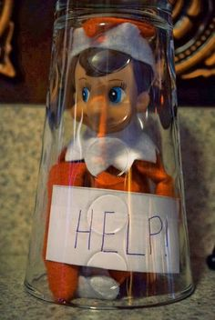 HELP! It looks like this elf is stuck in a cup. How did that happen?