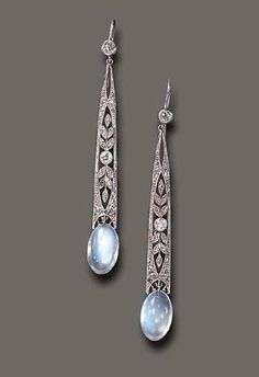 moonstone and diamond pendent earrings; Each old European-cut diamond collet, suspending a rose & old European-cut diamond elongated openwork plaque, to the cabochon moonstone terminal, mounted in platinum. Edwardian Jewelry, Antique Jewelry, Vintage Jewelry, Edwardian Style, Antique Earrings, Art Deco Jewelry, Fine Jewelry, Jewelry Design, Geek Jewelry
