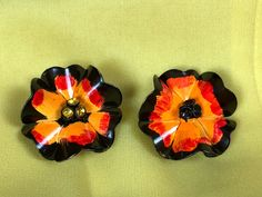Excited to share the latest addition to my #etsy shop: Gorgeous 1940s 1950s Orange & Black Earrings | Painted Metal Earrings | Clip On Earrings | Red Orange Flower Earrings #jewelry #earrings #orange #floral #black #avantgarde #earlobe #avantgardeearrings #wounded