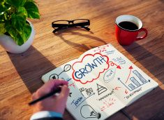 Businessman Sketching About Growth Concept stock photo