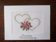 Pretty completed cross stitch card to celebrate a wedding anniversary featuring flowers and hearts stitched with metallic thread with silver coloured sticker 'happy anniversary' added to card front. | eBay!