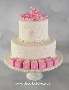 Diamond embossed christening cake with large flower and blocks
