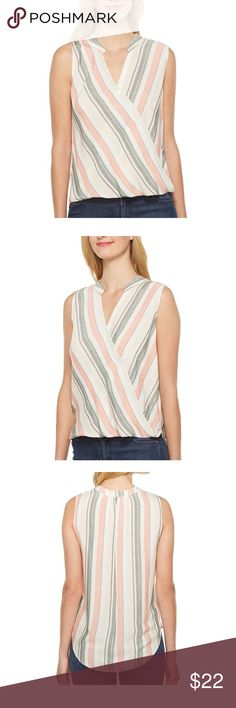 Sleeveless striped shirt (never worn) Smooth fabrication with a subtle stripe. Surplice front with button-up closure. Lay-flat collar and V-neckline. Sleeveless construction. Bubble front hem with droptail back. 100% rayon. Hand wash cold, dry flat. Imported. Measurements: Length: 30 in Tops