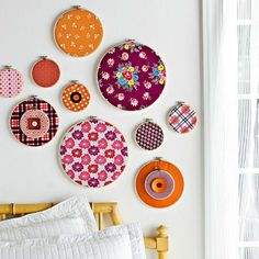 In the Hoop Art - Frame complementary fabrics in various embroidery hoops, then hang them for an instant wall collage. Create more dimension by layering hoops and buttons