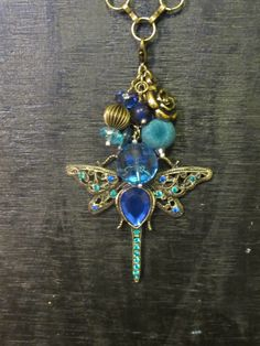 Dragonfly charm! Cute for summer!  Interchangeable Necklace Charm Cluster by MakeOverJewelry on Etsy, $15.00