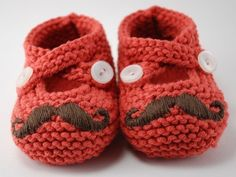 knit baby booties with embroidered 'staches