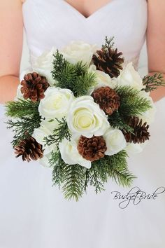 Christmas theme wedding flower bouquet with pine cones, pine, cedar and ivory roses.  Stunning for a winter wonderland theme wedding