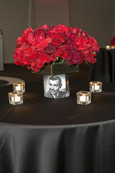centerpieces Party Theme - Hollywood Glam, via Flickr. ~ like the idea of the picture in the vase but not sure of the sq box of roses on top. I would go with out or put the Hollywood feathers in the vase.