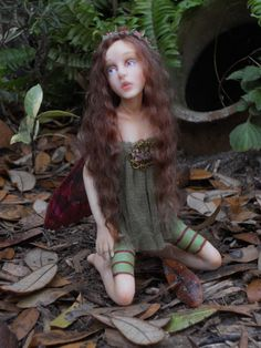 Makela is a one of a kind polymer clay faerie. She has handmade hand painted inset eyes and real eyelashes. A tiny paper flower wreath crowns her chocolate brown mohair locks. Her bodice is hand dyed silk illusion.  cherihiers.com