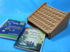 Custom essential oil display that holds your reference guides. backwoodwoodworks.com facebook.com/backwoodswoodworks