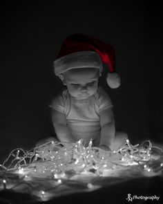 Baby Christmas photo. Someone is waiting for Santa. www.maddoxphoto.com