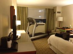 Place the treadmill in a large guest room.  Guest space/exercise space with a t.v.